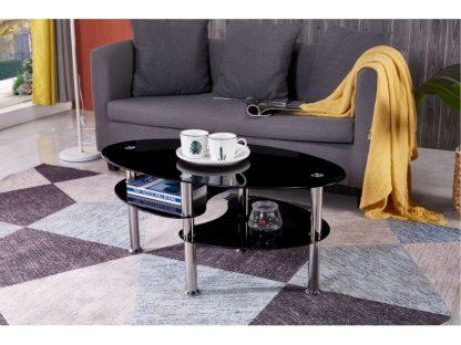 Beim ovalen Couchtisch Carly sind die Tischplatte und die zwei zusätzlichen Ablagen aus schwarzem Sicherheitsglas. Die runden Beine sind aus Edelstahl. Der Tisch wird zerlegt geliefert.