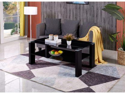 Der rechteckige Couchtisch Fibi hat eine Tischplatte und Ablage aus schwarzem Sicherheitsglas. Die stabilen Beine sind ebenfalls schwarz. Die Selbstmontage ist dank der mitgelieferten Anleitung sehr einfach.